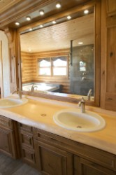 Log Home By Golden Eagle Log and Timber Homes - rustic countertop with dual basins