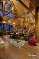 Log Home By Golden Eagle Log and Timber Homes - great room   glass wall