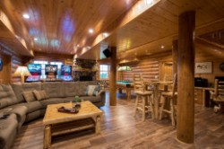Log Home By Golden Eagle Log and Timber Homes - lower level - family room area - view 3